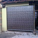 Гаражные подъемно-секционные ворота Алютех